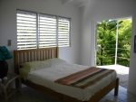 Bedroom with double doors leading to deck
