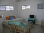 Multi-purpose room could be used as a third bedroom, study, artist studio or TV den