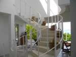 Attractive spiral staircase to multi-purpose room.