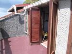 Doors opening onto private veranda off double bedroom