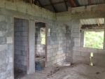Kitchen area with doorway to bedroom 1 and house bathroom