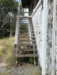 Steps in need of repair leading to main house level
