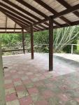 Partially covered front veranda