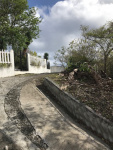 Looking around the corner at the top of the allowed road showing picket fence of Lot 38E